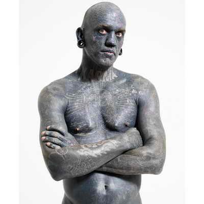 Человек с самым большим числом татуировок