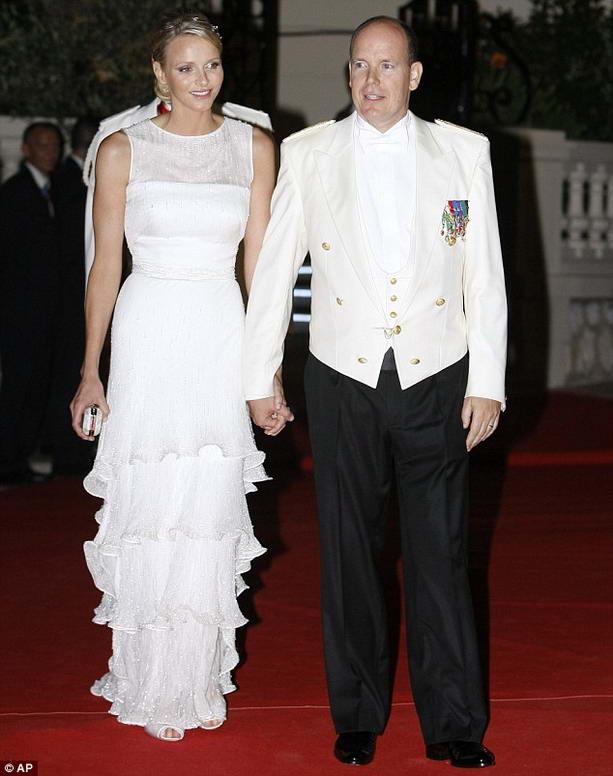 князь Монако Альберт II и Олимпийская чемпионка