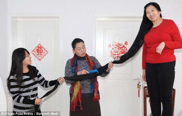 Самые длинные волосы в мире вырастила китаянка Ни Линмей